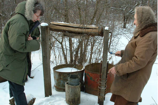 Woman at her well in rural Tambov, Russia